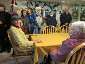 Bicycle carolers croon for Kern Village Assisted Living residents